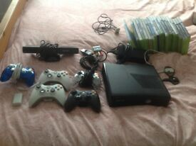 320gb slim Xbox 360 with Kinect,5 controllers,2 ear pieces,2 power packs,20 games and more!