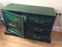 Hardwood sideboard finished in high gloss green.