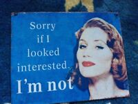 "Small metal sign ""sorry if I look interested - I'm not"""
