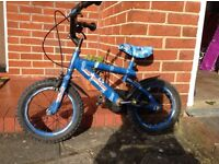 Blue child's bike. Raleigh, with stabilisers. Good condition.