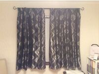 Black and silver curtains and black curtain rail