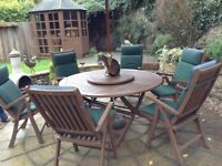 Garden table and six chairs with cushions