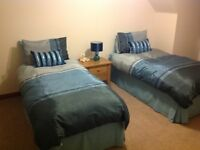 Two Single Divan Beds With 2 Full Size Drawers