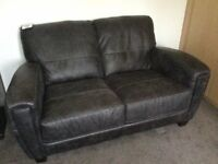 Stunning and extremely comfortable ex display 2 seater sofa from DFS in distressed grey leather
