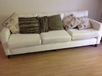 White 4 seater sofa plus armchair - excellent condition. Out of a Barrett show house.