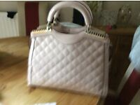 Lovely pink plain/quilted handbag