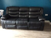 2 and 3 seater reclining sofas. Black faux leather