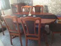 Extending cherry table and six chairs