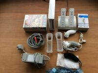 Nintendo wii with 4 games 2 controllers and 3 nunchucks