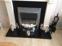Electric fire with coals or pebbles