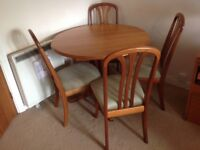 Dining table can extend, single pedestal leg 4 chairs with upholstered seats
