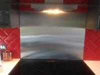 Cooker splash back in stainless steel