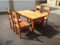 French oak extendable table and six chairs
