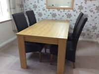 Dining Table and 4 Chairs, in very good condition.