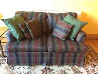 2- seater couch in great condition for sale with matching cushions.