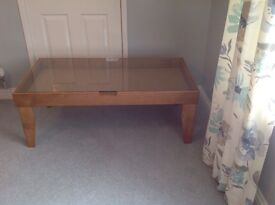 Glass top coffee table with solid oak frame and legs
