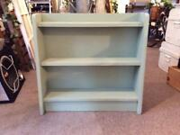 Set shelves painted in pale green . Measures 19cm d x 68 cm h x 71 cm w .