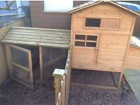 4 Chickens, complete with coop and feeders.