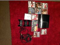 Play station 3 with 3 controllers and. 12 games