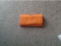 Ted Baker purse, orange with gold clasp and TB embolished in orange letters