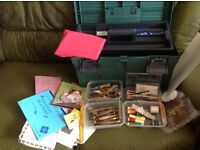 Lace making equipment, includes books, bobbins,and other equipment in a carry box.