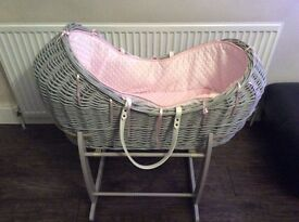 Pink and grey wicker basket with a rocking stand