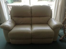 Leather cream coloured reclining two seater sofa
