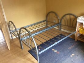 Sturdy twin metal beds in good condition.
