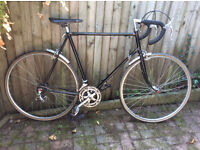 Classic vintage road bike, light 60cm steel frame, maybe Reynolds 531, alloy hubs/rims, good tyres