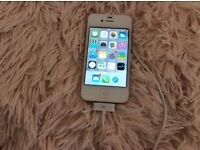 White apple I phone 4s in perfect working order and good condition. 3 years old