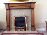 Oak Fireplace and Surround with marble hearth together with electric fire