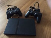 PlayStation 2 Slim, with Controllers, Leads and Games
