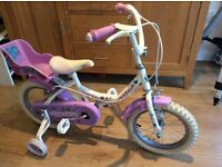 Girl's white and pink Townsend bike with stabilisers
