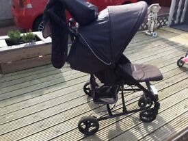 Mother are. VIO switch buggy in cream and brown