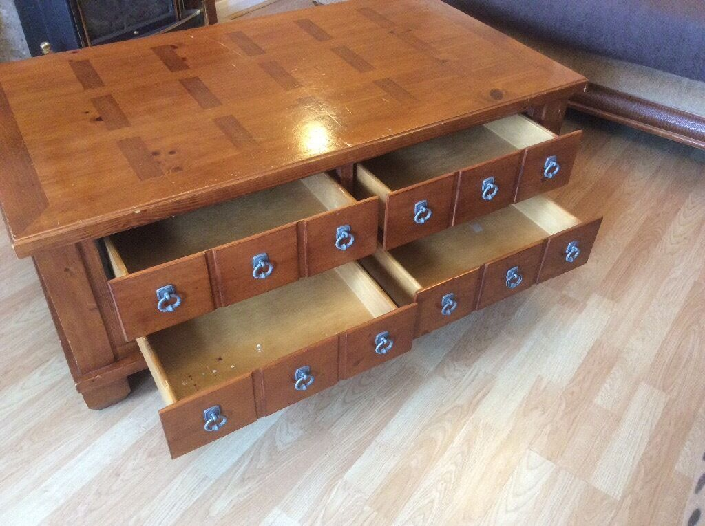 large solid wood coffee table with 4 drawers 72cm long 127cm wide 50cm large solid