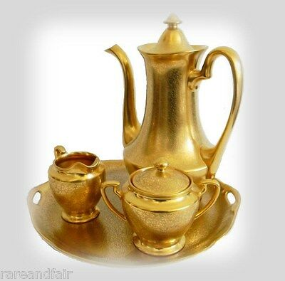 Pickard gold tea set with teapot, creamer, sugar, and underplate - marked