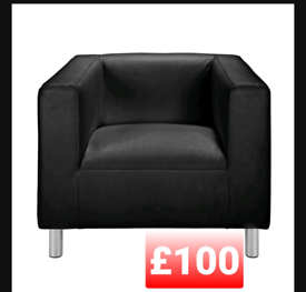 Faux leather armchair. Black