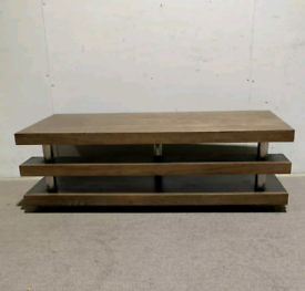 Large oak coffee table with a shelf underneath the table top