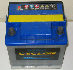 an auto battery. Any battery. Will be used in a lawn mower   :-)