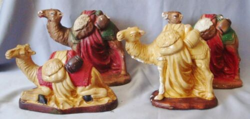 FOUR PIECES VINTAGE CHALKWARE CRECHE CAMELS-THREE STANDING, ONE IN REPOSE