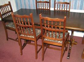 Dark Oak finish solid wood dining room suite with 6 chairs (including 2 carvers)