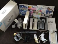 Wii Console with 2 remotes, 2numchuks, Wii sport Mario and other games-Hardly Used