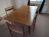 Mid-century modern solid wood extendable dining table