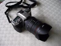 Minolta Dynax 5 - 35 mm film camera and Sigma zoom lens