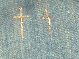 2 gold catholic crosses