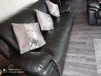 2 X 3 black leather settees