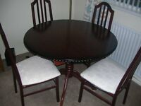 Extending mahogany dining set with 6 chairs