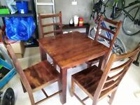 Solid wood dining room table and 4 chairs