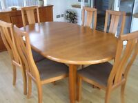 Dining room suite consisting of extending table, 6 chairs and a sideboard