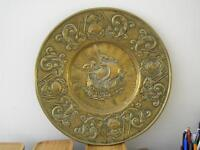 Large round pressed brass hanging of a sailing vessel